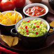 Guacamole with avocado, lime, chili and tortilla chips, salsa — Stock Photo #42112207