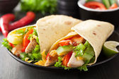 Mexican tortilla wrap with chicken breast and vegetables — Stock Photo