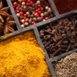 Spices in box pink and black pepper, ground paprika, curry, anise clove cumin — Stock Photo #42949941