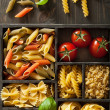 Various pasta in black wooden box — Stock Photo #42950417