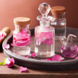 Alchemy and aromatherapy set with rose flowers and flasks  — Stock Photo #44257659