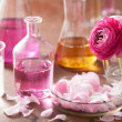 Alchemy and aromatherapy set with ranunculus flowers and flasks — Stock Photo #46252637