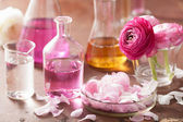 Alchemy and aromatherapy set with ranunculus flowers and flasks — Stock Photo