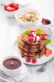 Pancakes with berry and jam for breakfast — Stock Photo