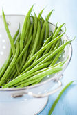 Fresh green beans in colander — Stock Photo
