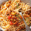 Cooking italian pasta spaghetti bolognese — Stock Photo