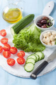 Ingredients for salad with tomatoes cucumber olives and feta che — Stock Photo