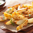 Baked potato wedges with yogurt dip — Stock Photo #47823203