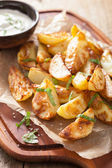 Baked potato wedges with yogurt dip — Foto de Stock
