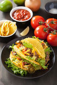 Mexican taco shells with beef and vegetables  — Stock Photo