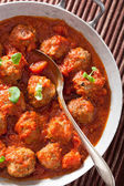 Meatballs with tomato sauce in pan with spoon  — Stock Photo