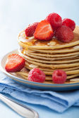 Pancakes with berry and honey — Photo