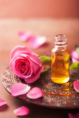 Rose flower and essential oil. spa and aromatherapy  — Stock Photo