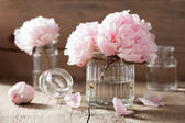Beautiful pink peony flowers bouquet in vase — Stock Photo