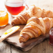 Fresh croissants with jam for breakfast — Stock Photo #49540431