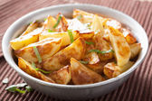 Baked potato wedges in bowl — Stock Photo
