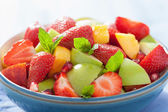 Fresh fruit salad with strawberry, apple, nectarine, pomegranate — Stock fotografie