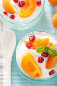 Healthy breakfast with yogurt apricot pomegranate  — Stock Photo