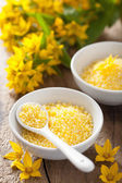 Spa with yellow herbal bath pearls and flowers  — Stock Photo