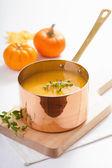Pumpkin soup in copper pot  — Stock Photo