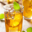 Glass of ice tea with lemon and melissa — Stock Photo #51242389