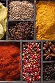 Spices in box. pink black pepper paprika powder curry bay leaf a — Stock Photo
