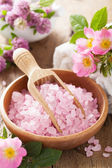 Spa with pink herbal salt and wild rose flowers — Stock Photo