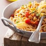 Cooking italian pasta spaghetti bolognese — Stock Photo