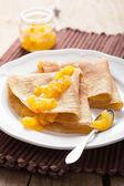 Pancakes with orange marmalade  — Stock Photo