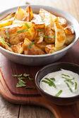 Baked potato wedges with yogurt dip — Stock Photo