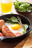 Fried egg sausages tomatoes in pan for breakfast  — Foto de Stock