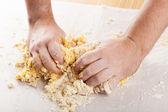 Man hands kneading a dough  — Stock Photo