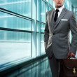 Businessman inside modern building - Stock Photo