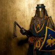 Medieval knight on golden background — Stock Photo