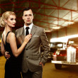 Couple in retro garage — Stock Photo #12455541