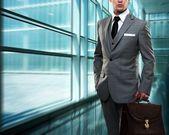 Businessman inside modern building — Stock Photo