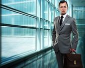 Businessman inside modern building — Stock Photo