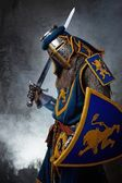 Medieval knight on abstract background — Stock Photo