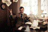 Angry businessman throwing a documents — Stock Photo
