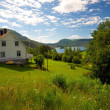 Farmhouse in scandinavian landscape - Stock Photo