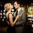 Retro couple against slot machines — Stock Photo #12467167