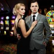Retro couple against slot machines — Stock Photo #12467238