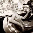 Smiling retro womin convertible — Stock Photo #12467692