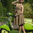 Woman in retro dress with a scooter - Lizenzfreies Foto