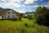 Farmhouse in scandinavian landscape — Stock Photo