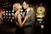 Retro couple against slot machines — Stock Photo