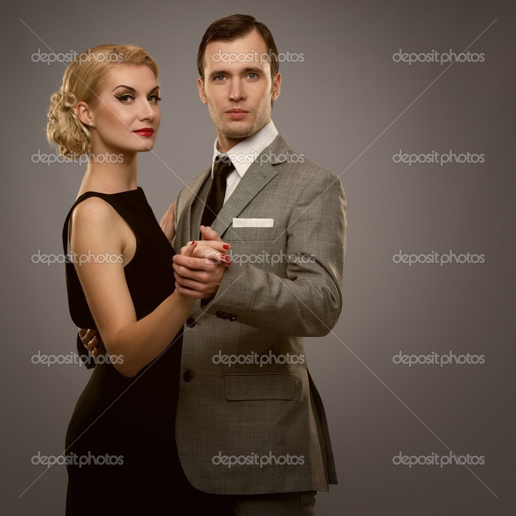 Retro couple on grey background — Stock Photo #12742159
