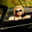 Woman in retro car — Stock fotografie