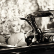 Retro couple in convertible — Stock Photo #13311104
