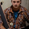 Young man with a skateboard — Stock Photo #13311134